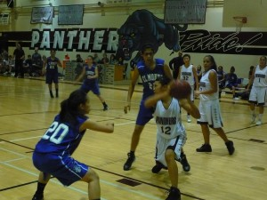 Rosemead High School's Lily Che gathered a rebound as El Monte High School's Tonia Tran (20) and Sandra Gutierrez (22) defended in Rosemead's 38-33 Mission Valley League win on Jan. 21.