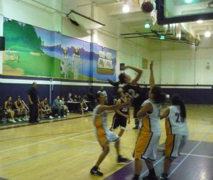In a Crowd...Rosemead High School junior guard Jeanne Tran scored a basket against three Mountain View High School defenders in Rosemead's 45-32 Mission Valley League Girl's Varsity Basketball win that tied both teams for first place in league on Jan. 30.
