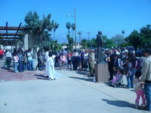 Participants prayed, led by Brother Heherson Balabbo, CMF of San Gabriel Mission, and mission Altar Server Elizabeth Lyons, as San Gabriel Mission historic cross was rededicated on March 7 at the 234-year-old church building.  Photo courtesy of San Gabriel Mission.