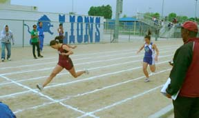 Rosemead High School senior Annalyssia VanBeers leaned at the finish line as she won the 200 meters in 28.47 against host El Monte on April 2 in a Mission Valley League meet won by Rosemead by a score of 89-47. Photo by C. Lyons.