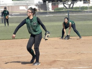 DEFENSE IS READY...San Gabriel Mission High School Pioneers' freshman starting pitcher Nicole Holguin pitched and then got ready to defend along with junior leftfielder Charly Rae Guttierez and sophomore shortstop Amanda Garcia in the CIF-SS softball playoffs. San Gabriel Mission, which included mostly ninth and tenth grade student athletes on this year's team, lost 9-2 in the second round May 26, to Grace Brethren, after the Pioneer's 7-0 first round win against Twentynine Palms. The Pioneers also won the Horizon League championship.  Photo by Chuck Lyons.