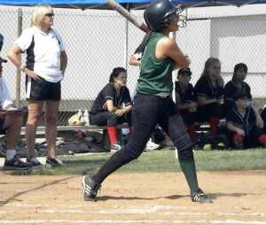 Sophomore shortstop Amanda Garcia of San Gabriel Mission connected on pitch for a single in game against visiting Grace Brethren on May 26 at mission's home field. Photo by Chuck Lyons.