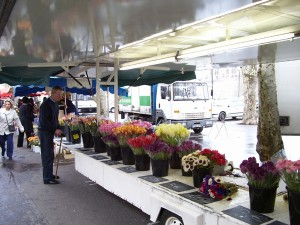 Fragrant flowers of many kinds are offered at the same market.