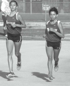 Rosemead High School seniors Brittnie Munoz (left) and Elizabeth Lyons took a commanding early lead and appear in unison in the early part of Mission Valley League girl's varsity 2.92 mile race against visiting Arroyo High School on Oct. 8. Rosemead won 23-32 (low score wins) to improve its record to 2-0 in league as it continues its quest for the league title in dual meet action.