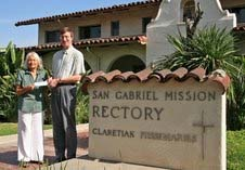 Armida Higuera of Monterey Park received a check from San Gabriel Mission Pastor Rev. Steve Niskanen, CMF, for being the La Fiesta de San Gabriel grand prize drawing winner.