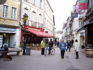 We stroll down a narrow street in the quaint wine city of Beaune.