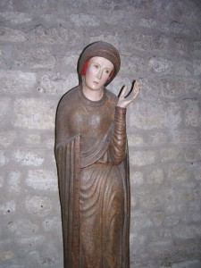 A medieval statue of the Virgin Mary seen at the Cluny Museum.