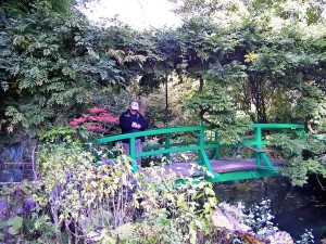 I stand on the very bridge depicted in many of Monet's paintings of his lily pond.