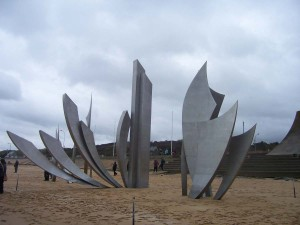 "The sculpture at Omaha Beach representing ""The Wings of Hope"", ""The Rise of Freedom"" and ""The Wings of Fraternity."""