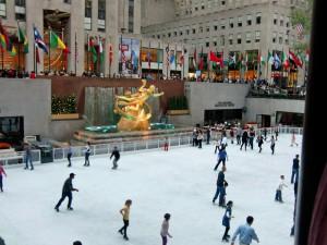Skaters glide over the ice at Rockefeller Center