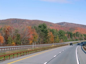 The highway leads us into the Adirondacks where the trees are burnished with autumn.