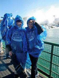 The author and photographer, dressed in ridiculous plastic coats, are about to enter the spray of the Canadian Falls.