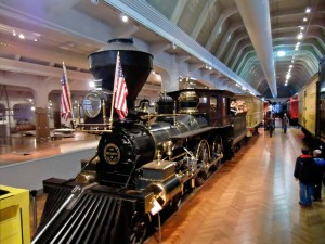 One of the early trains looks small compared to the Allegheny locomotive.