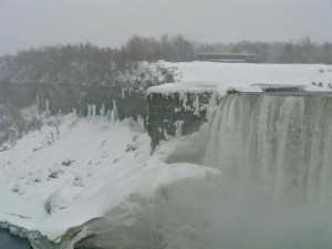 Even during winter the falls continue their plunge over the precipice.