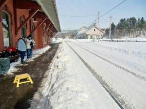 At the Waterbury station the rails are only think black lines in the snow.