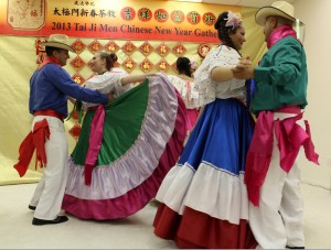 A folk dance group displays the traditional costumes and beautiful dance of Costa Rica.