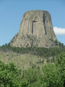 Devils Tower, over one thousand feet in height, seems to rise out of the land.