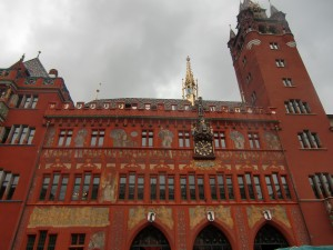 Amazing is Basel's Town Hall or Rathaus of vibrant brick red sandstone and golden towers.