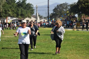 Women in the 35+ age group racing to the finish line balancing their pancakes as part of the great pancake races held at Smith Park in San Gabriel on April 19