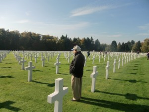 "The author, Charles ""Norm"" Stevens, stands among the crosses at the Luxembourg American Cemetery."