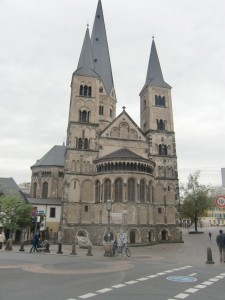 We admire the three great spires rising from the Bonn Munster Church as bells clanging loud and long  call the people to mass.