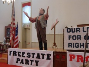 At Lane University we see a play put on by local actors about whether Kansas would be a slave state or a free state.