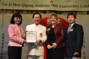 Mary Su, mayor pro tem of the City of Walnut (first from left); Councilmember Eric Ching of the City of Walnut (first from right); Councilmember Nancy Tragarz of the City of Walnut (second from right); jointly present a certificate of appreciation to Dr. Hong, Tao-Tze, Zhang-men-ren of Tai Ji Men (second from left) for Tai Ji Men's promotion of love and peace as well as its spreading of positive energy over the years.