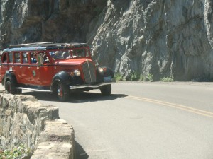 "We climb the ""Road to the Sun"" in special red tourist cars like this one."