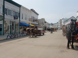 A street scene at the village on Mackinac Island. Note the horses pulling wagons as no cars are allowed on the island.