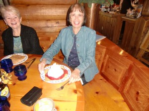 Dolores at Al Johnson's restaurant about to dine on Swedish pancakes topped with strawberries and whipped cream.