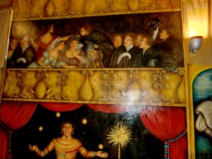 Murals painted on the interior walls of the opera house provide an audience of sorts.