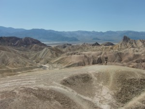 The view of far away Death Valley with its salt flats, brush land and dunes, is visible from Zabriskie Point.