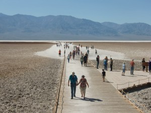 At Bad Water tourists walk out toward the salt flats on a path composed of compressed salt.