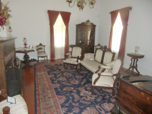 The living room of the John Rains House has furniture of the period.