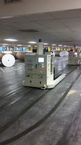 One of the robots waits its turn to load rolls of paper onto the presses.