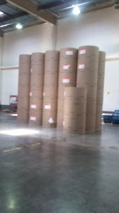 Rolls of paper are stacked in the warehouse.