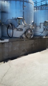 Large storage tanks receive the juice from the crushed grapes.