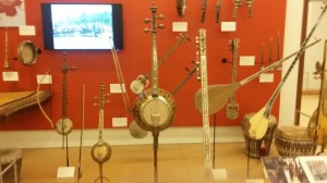 Banjos and banjo-like instruments fill another display case.