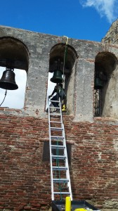 Workers are repairing the bells and all the structures as the l776 Mission at San Juan Capistrano.