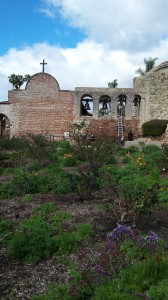 Flowers enhance the beauty of he old brick and stone structure of the museum.