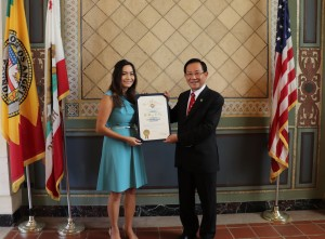 On behalf of Los Angeles Mayor Eric Garcetti, Commissioner Jessica Caloza of the Board of Public Works, left, presents a certificate of recognition to Dr. Hong, Tao-Tze, Zhang-men-ren (grandmaster) of Tai Ji Men, for his dedication to preserve traditional Chinese culture and promote peace.