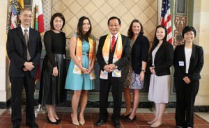On behalf of Los Angeles Mayor Eric Garcetti, Commissioner Jessica Caloza of Public Works of the City, third from left, together with Erin Bromaghim, director of Olympic and Paralympic Development of Los Angeles City, third from right, receives Dr. Hong, Tao-Tze, grandmaster of Tai Ji Men, and Tai Ji Men members.