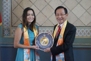On behalf of Los Angeles Mayor Eric Garcetti, Commissioner Jessica Caloza of Public Works of the City, left, is presented with a special clock by Dr. Hong, Tao-Tze, grandmaster of Tai Ji Men. The face of the clock bears a compass of conscience, which symbolizes that all are encouraged to follow the guidance of their conscience at all times.