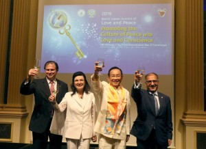 From left, Sandor and Herta Habsburg-Lothringen, founders of the Flame of Peace; Dr. Hong, Tao-Tze, president of FOWPAL; Ambassador Yusuf Abdulkarim Bucheeri of Bahrain to the UN (Vienna), give a toast to their guests. (AP Images)