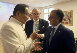 Dr. Hong, Tao-Tze, president of FOWPAL, left, and Ambassador Yusuf Abdulkarim Bucheeri of Bahrain to the UN (Vienna), exchange ideas about celebrating the UN's designation of April 5 the International Day of Conscience. (AP Images)